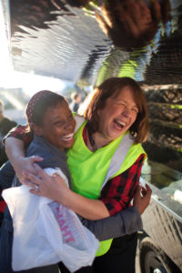 An MLTC volunteer and patron laughing together.